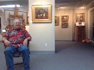 Artist Bruce Williamson enjoying his visitors. We also enjoyed his great paintings.